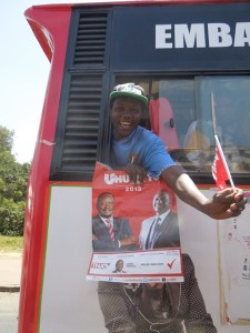 A Jubilee supporter in Nairobi on the way to the last rally before the elections.