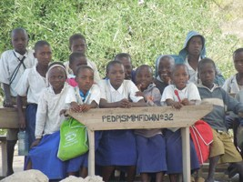 Unfortunately, these kids were quite some of those that did not have a classroom and were thus thought under the tree.