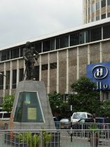 Monument of a Mau Mau fighter in front of the Hilton hotel in downtown Nairobi