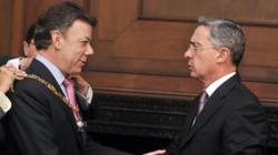 Juan Manuel Santos and Álvaro Uribe (c) es.wikipedia.org